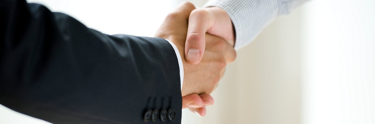 Photo of two men shaking hands