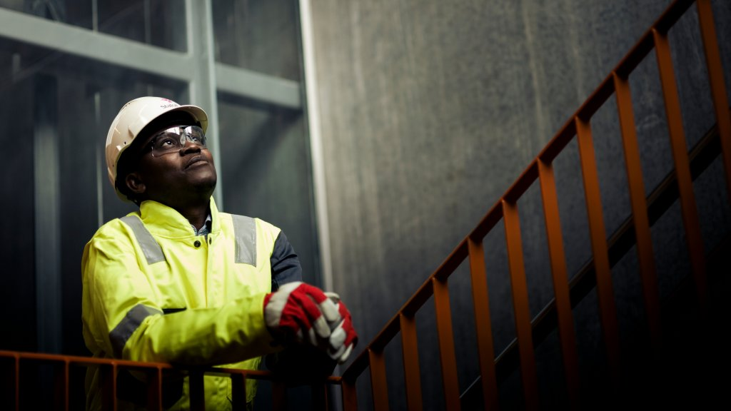 Photo of Statoil employee Reginald Unamba in boiler suit with gloves, googles and helmet