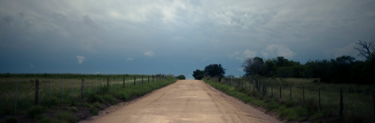 Photo of a countryside road with the sky turning dark as a storm builds up near Kenedy, South Texas